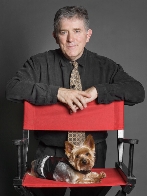 Studio portrait of Rick Caran and Jilli dog, the performing Yorkie from Animal Planet